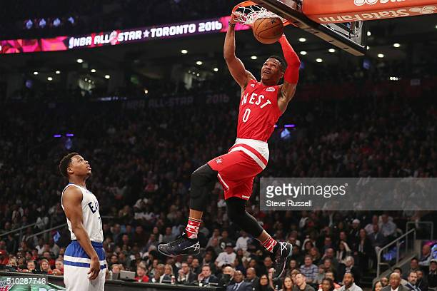 Kyle Lowry has the best spot to watch Oklahoma City Thunder guard Russell Westbrook dunk during the 65th NBA AllStar Game at the Air Canada Centre in...