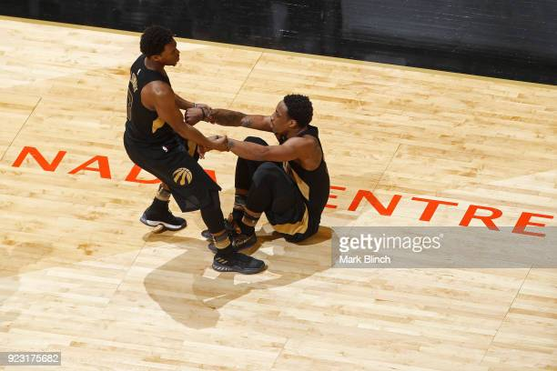 Kyle Lowry helps up DeMar DeRozan of the Toronto Raptors during the game against the Utah Jazz on January 26 2018 at the Air Canada Centre in Toronto...