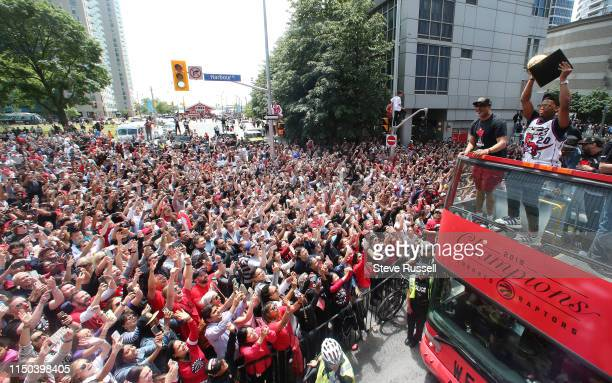 Kyle Lowry hoists the Larry O'Brien NBA Championship Trophy as the Toronto Raptors hold their victory parade after beating the Golden State Warriors...