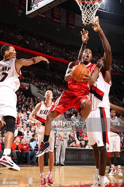 Kyle Lowry of the Houston Rockets goes up for a shot past Greg Oden of the Portland Trail Blazers during the season opening game on October 27 2009...