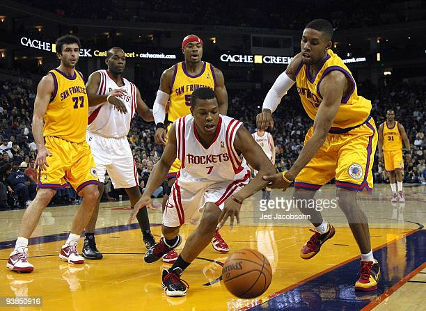 f5e7c5e61 Kyle Lowry of the Houston Rockets scrambles for the ball with CJ Watson of  the Golden