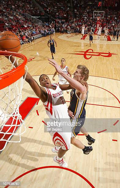Kyle Lowry of the Houston Rockets shoots the ball over Andrei Kirilenko of the Utah Jazz on January 8 2011 at the Toyota Center in Houston Texas NOTE...