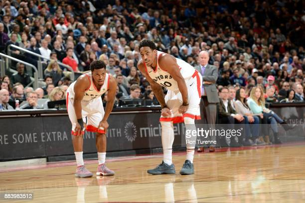Kyle Lowry of the Toronto Raptors and DeMar DeRozan of the Toronto Raptors look on during the game against the Charlotte Hornets on November 29 2017...