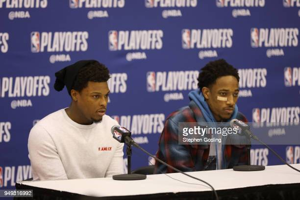 Kyle Lowry of the Toronto Raptors and DeMar DeRozan of the Toronto Raptors speak with the media during a press conference after the game against the...