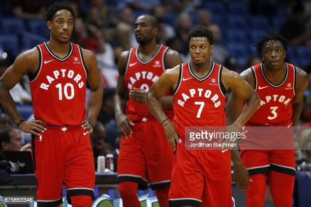 Kyle Lowry of the Toronto Raptors and DeMar DeRozan react during the first half of a game against the New Orleans Pelicans at the Smoothie King...