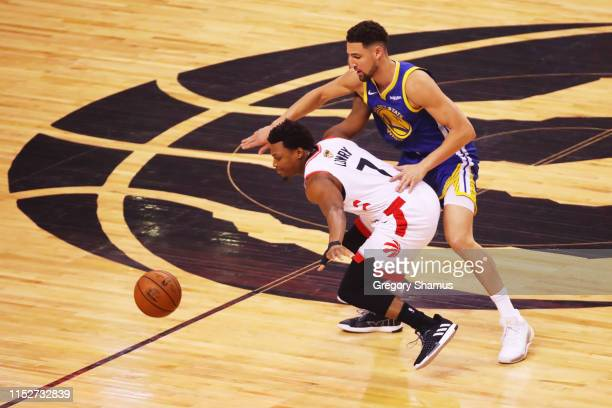 Kyle Lowry of the Toronto Raptors and Klay Thompson of the Golden State Warriors battle for the ball in the first quarter during Game One of the 2019...