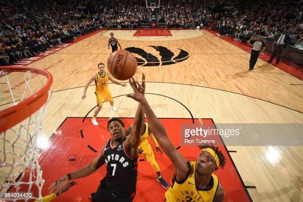 Kyle Lowry of the Toronto Raptors and Myles Turner of the Indiana Pacers go for a rebound on December 1 2017 at the Air Canada Centre in Toronto...