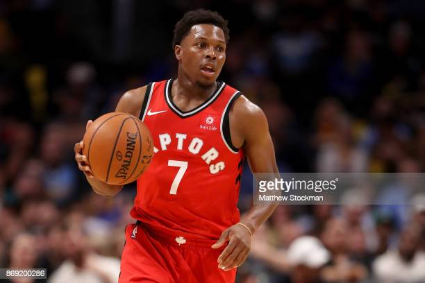 Kyle Lowry of the Toronto Raptors brings the ball down the court against the Denver Nuggets at the Pepsi Center on November 1 2017 in Denver Colorado...