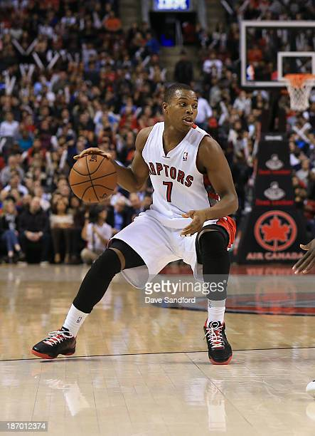 Kyle Lowry of the Toronto Raptors brings the ball up court against the Boston Celtics during their NBA game at the Air Canada Centre on October 30...