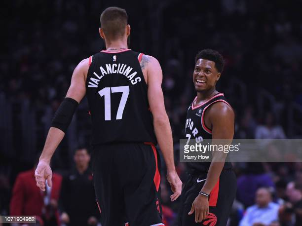 Kyle Lowry of the Toronto Raptors celebrates a 10374 lead with Jonas Valanciunas at the end of the third quarter at Staples Center on December 11...