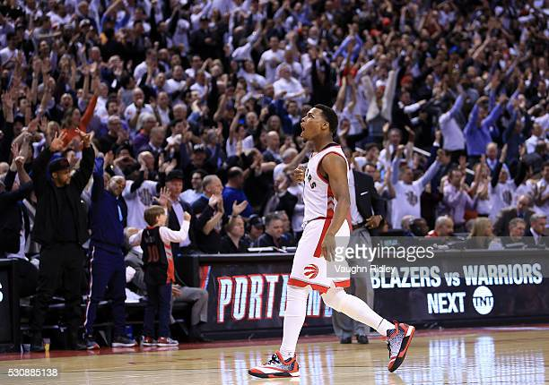Kyle Lowry of the Toronto Raptors celebrates a 3pointer late in the second half of Game Five of the Eastern Conference Semifinals against the Miami...