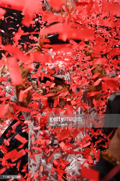 Kyle Lowry of the Toronto Raptors celebrates after defeating the Milwaukee Bucks during Game Six of the Eastern Conference Finals on May 25 2019 at...