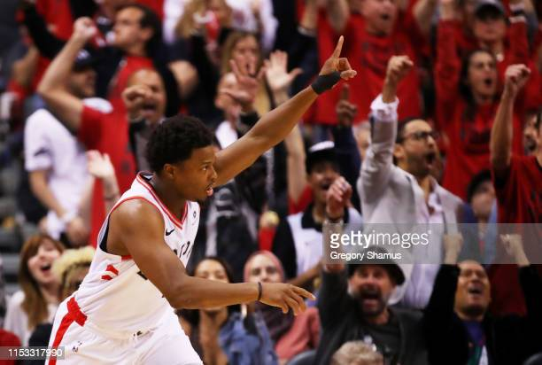 Kyle Lowry of the Toronto Raptors celebrates the play against the Golden State Warriors in the first half during Game Two of the 2019 NBA Finals at...
