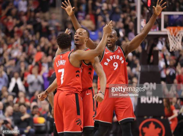 Kyle Lowry of the Toronto Raptors celebrates with Norman Powell and Serge Ibaka after scoring a threepointer at the buzzer at the end of the first...