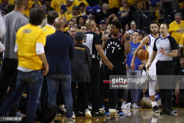 Kyle Lowry of the Toronto Raptors complains to referee Marc Davis against the Golden State Warriors in the second half during Game Three of the 2019...