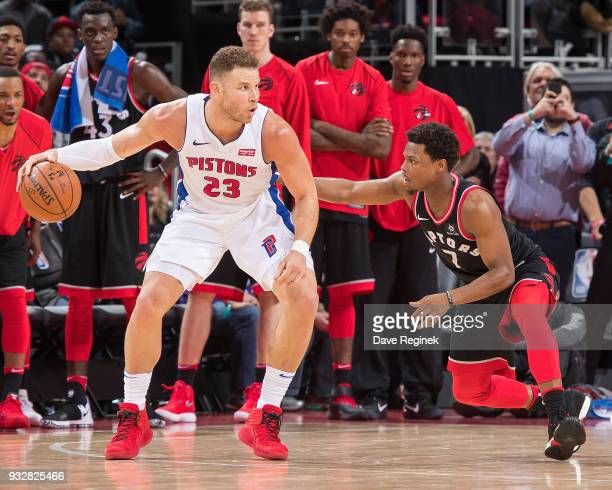 Kyle Lowry of the Toronto Raptors defends against Blake Griffin of the Detroit Pistons during OT of an NBA game at Little Caesars Arena on March 7...