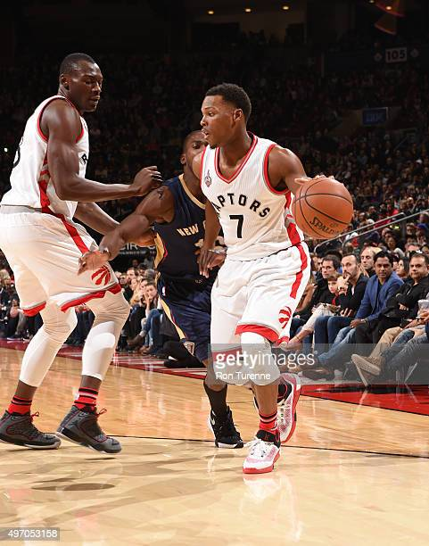 Kyle Lowry of the Toronto Raptors dribbles the ball against the New Orleans Pelicans on November 13 2015 at the Air Canada Centre in Toronto Ontario...