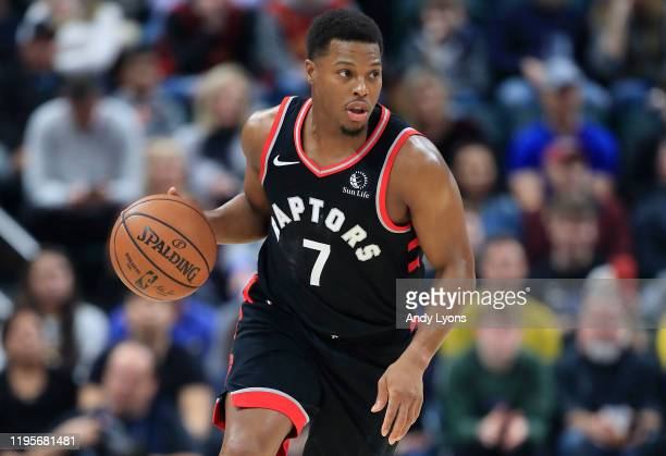Kyle Lowry of the Toronto Raptors dribbles the ball against the Indiana Pacers during the game at Bankers Life Fieldhouse on December 23, 2019 in...