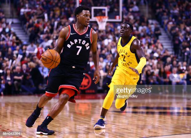 Kyle Lowry of the Toronto Raptors dribbles the ball as Darren Collison of the Indiana Pacers defends during the second half of an NBA game at Air...