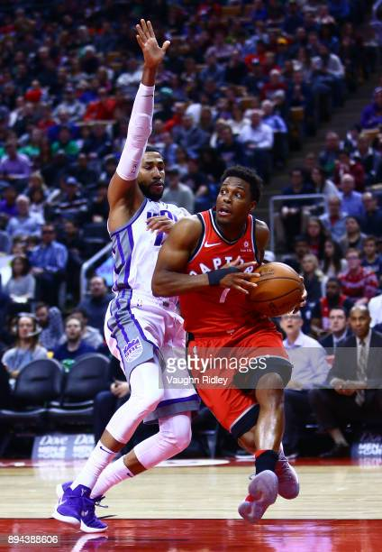 Kyle Lowry of the Toronto Raptors dribbles the ball as Garrett Temple of the Sacramento Kings defends during the second half of an NBA game at Air...