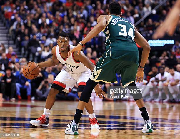 Kyle Lowry of the Toronto Raptors dribbles the ball as Giannis Antetokounmpo of the Milwaukee Bucks defends during the second half of an NBA game at...