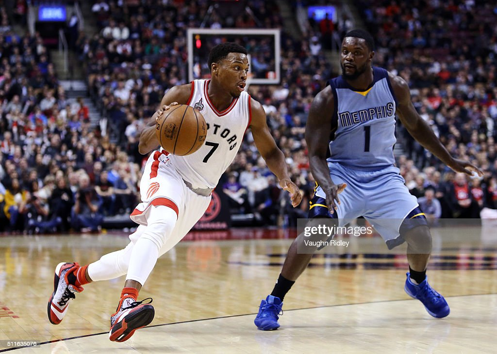 Kyle Lowry #7 of the Toronto Raptors dribbles the ball as Lance Stephenson #1 of the Memphis Grizzlies defends during the second half of an NBA game at the Air Canada Centre on February 21, 2016 in Toronto, Ontario, Canada.