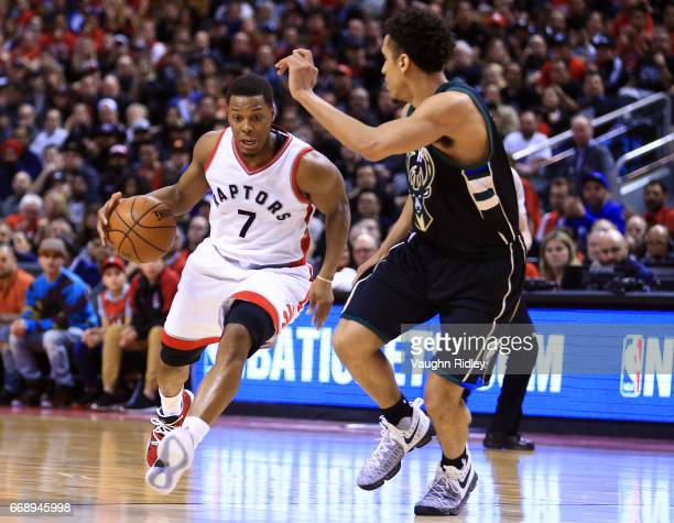 Kyle Lowry of the Toronto Raptors dribbles the ball as Malcolm Brogdon of the Milwaukee Bucks defends in the second half of Game One of the Eastern...