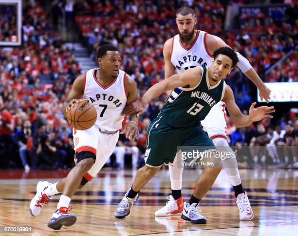 Kyle Lowry of the Toronto Raptors dribbles the ball as Malcolm Brogdon of the Milwaukee Bucks defends in the second half of Game Two of the Eastern...
