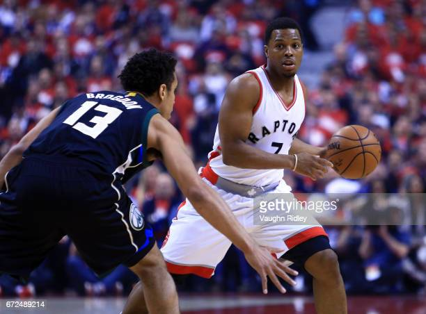 Kyle Lowry of the Toronto Raptors dribbles the ball as Malcolm Brogdon of the Milwaukee Bucks defends in the first half of Game Five of the Eastern...