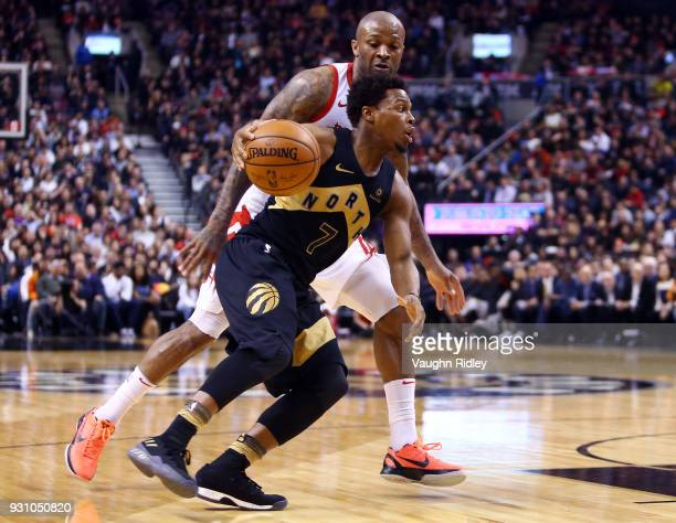 Kyle Lowry of the Toronto Raptors dribbles the ball as PJ Tucker of the Houston Rockets defends during the second half of an NBA game at Air Canada...