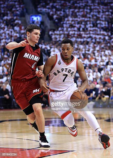 Kyle Lowry of the Toronto Raptors dribbles the ball as Tyler Johnson of the Miami Heat defends in Game Seven of the Eastern Conference Quarterfinals...
