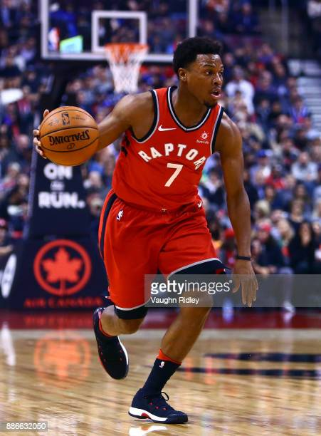 Kyle Lowry of the Toronto Raptors dribbles the ball during the first half of an NBA game against the Phoenix Suns at Air Canada Centre on December 5...