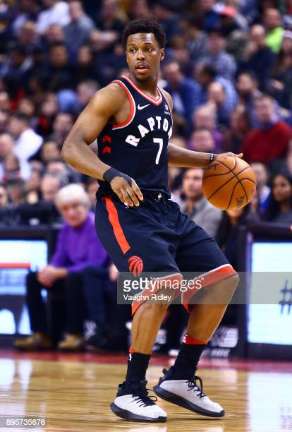 Kyle Lowry of the Toronto Raptors dribbles the ball during the first half of an NBA game against the Brooklyn Nets at Air Canada Centre on December...