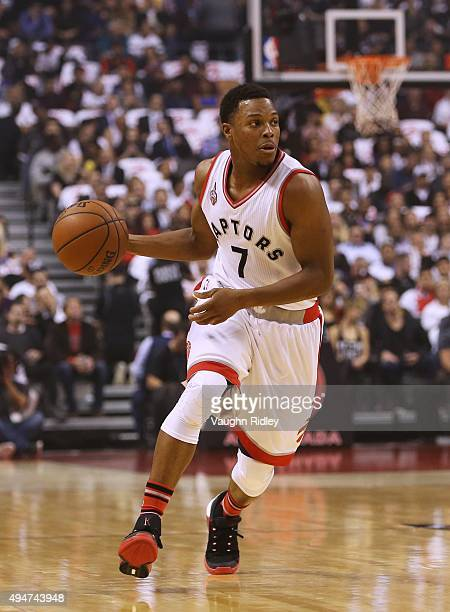 Kyle Lowry of the Toronto Raptors dribbles the ball during the NBA season opener against the Indiana Pacers at Air Canada Centre on October 28 2015...