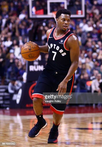 Kyle Lowry of the Toronto Raptors dribbles the ball during the second half of an NBA game against the Indiana Pacers at Air Canada Centre on December...