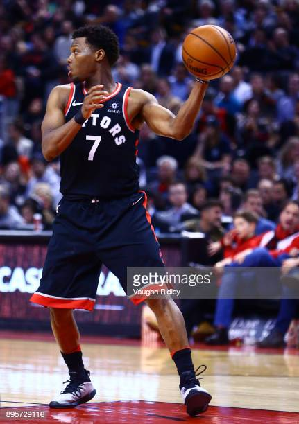 Kyle Lowry of the Toronto Raptors dribbles the ball during the second half of an NBA game against the Brooklyn Nets at Air Canada Centre on December...