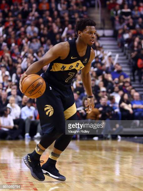 Kyle Lowry of the Toronto Raptors dribbles the ball during the second half of an NBA game against the Houston Rockets at Air Canada Centre on March 9...