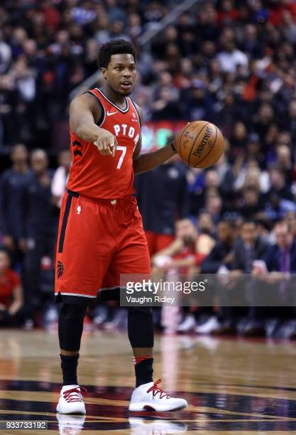 Kyle Lowry of the Toronto Raptors dribbles the ball during the second half of an NBA game against the Oklahoma City Thunder at Air Canada Centre on...