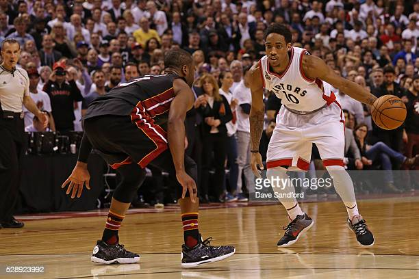 Kyle Lowry of the Toronto Raptors dribbles the ball while guarded by Dwyane Wade of the Miami Heat in Game Two of the Eastern Conference Semifinals...