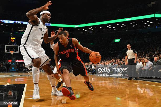 Kyle Lowry of the Toronto Raptors drives against Andray Blatche of the Brooklyn Nets during the first ever regular home season game at the Barclays...
