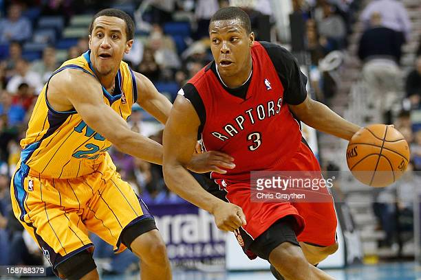 Kyle Lowry of the Toronto Raptors drives the ball around Brian Roberts of the New Orleans Hornets at New Orleans Arena on December 28 2012 in New...