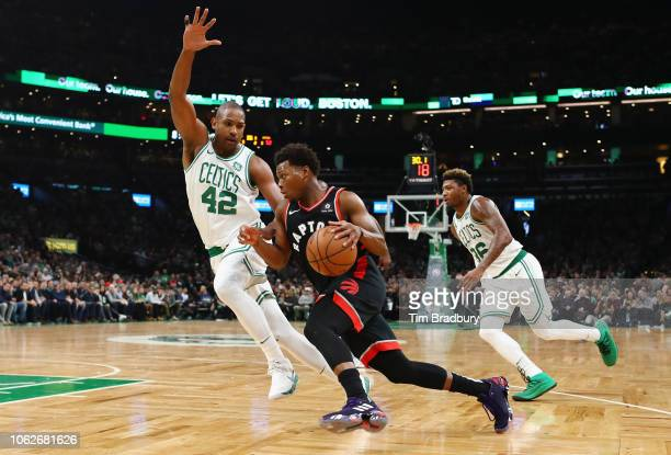 Kyle Lowry of the Toronto Raptors drives to the basket against Al Horford of the Boston Celtics during the first half at TD Garden on November 16...