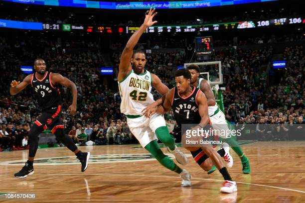 Kyle Lowry of the Toronto Raptors drives to the basket against Al Horford of the Boston Celtics on January 16 2019 at the TD Garden in Boston...