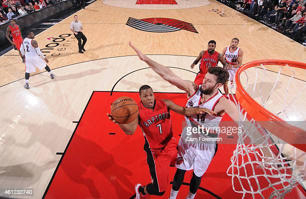 Kyle Lowry of the Toronto Raptors drives to the basket against Joel Freeland of the Portland Trail Blazers on December 30 2014 at the Moda Center...