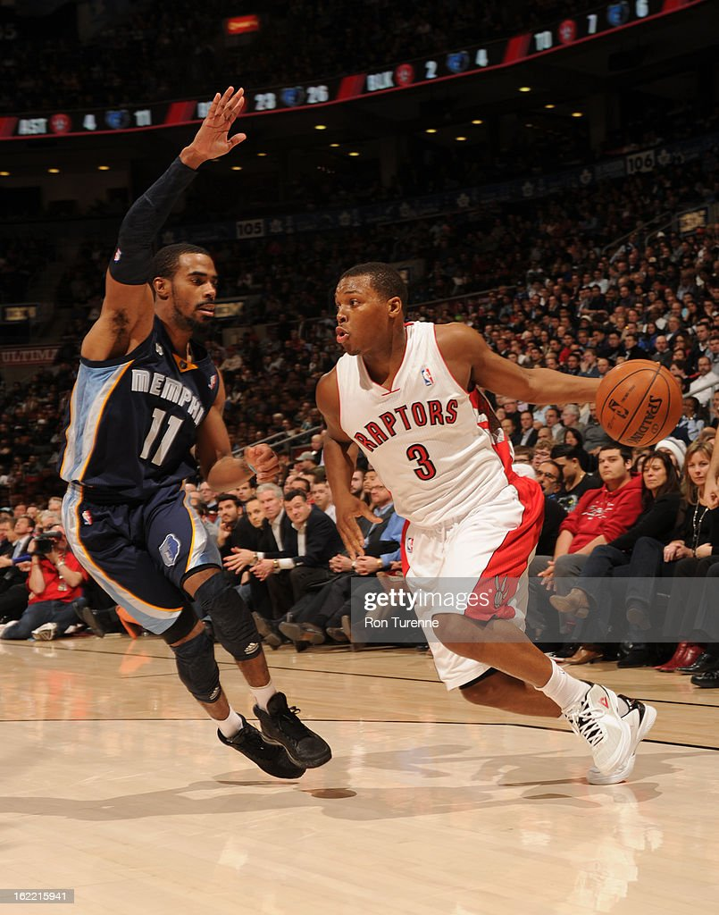 Kyle Lowry #3 of the Toronto Raptors drives to the basket against Mike Conley #11 of the Memphis Grizzlies on February 20, 2013 at the Air Canada Centre in Toronto, Ontario, Canada.