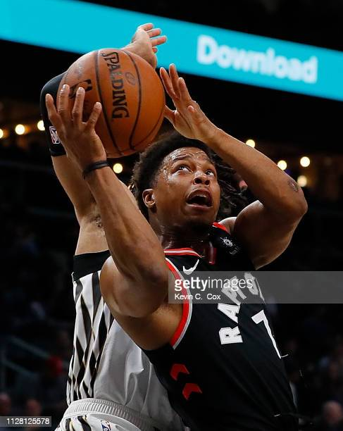 Kyle Lowry of the Toronto Raptors drives to the basket against DeAndre' Bembry of the Atlanta Hawks at State Farm Arena on February 07 2019 in...