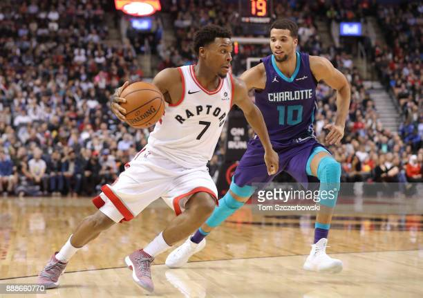Kyle Lowry of the Toronto Raptors drives to the basket against Michael CarterWilliams of the Charlotte Hornets during NBA game action at Air Canada...