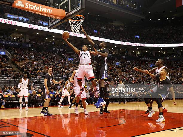 Kyle Lowry of the Toronto Raptors drives to the basket against the Golden State Warriors on December 5 2015 at Air Canada Centre in Toronto Ontario...