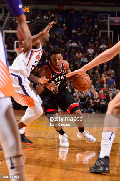 Kyle Lowry of the Toronto Raptors drives to the basket against the Phoenix Suns on December 13 2017 at Talking Stick Resort Arena in Phoenix Arizona...