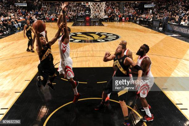 Kyle Lowry of the Toronto Raptors drives to the basket against the Houston Rockets on March 9 2018 at the Air Canada Centre in Toronto Ontario Canada...